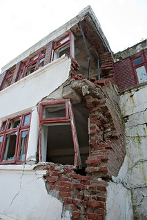 Falling down building