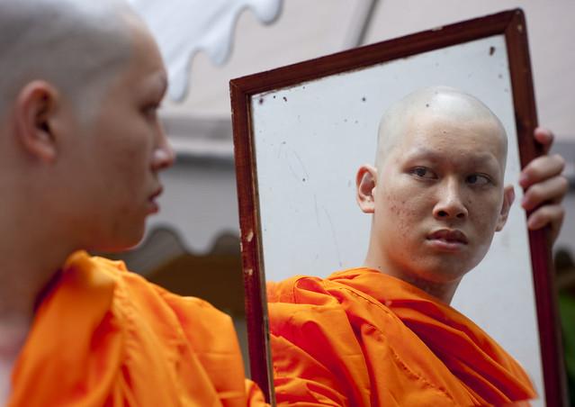 Novice discovering his new haircut, Bangkok, Thailand