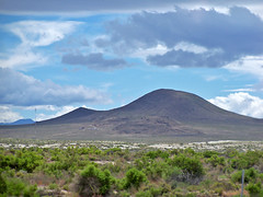 prairie(0.0), loch(0.0), shield volcano(0.0), volcanic landform(0.0), steppe(1.0), horizon(1.0), cloud(1.0), mountain(1.0), volcano(1.0), plain(1.0), hill(1.0), highland(1.0), ridge(1.0), natural environment(1.0), plateau(1.0), fell(1.0), landscape(1.0), wilderness(1.0), grassland(1.0), mountainous landforms(1.0),
