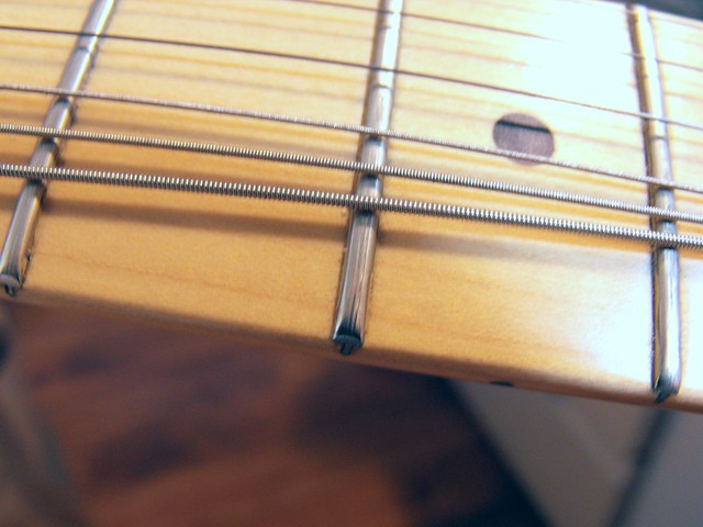 Photo:Frets are grooved.. By Tim Patterson