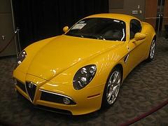 automobile(1.0), automotive exterior(1.0), alfa romeo(1.0), wheel(1.0), vehicle(1.0), automotive design(1.0), alfa romeo 8c(1.0), auto show(1.0), alfa romeo 8c competizione(1.0), land vehicle(1.0), supercar(1.0), sports car(1.0),