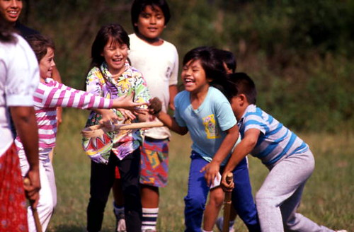 Seminole children playing stick ball: Big Cypress Reservation, Florida