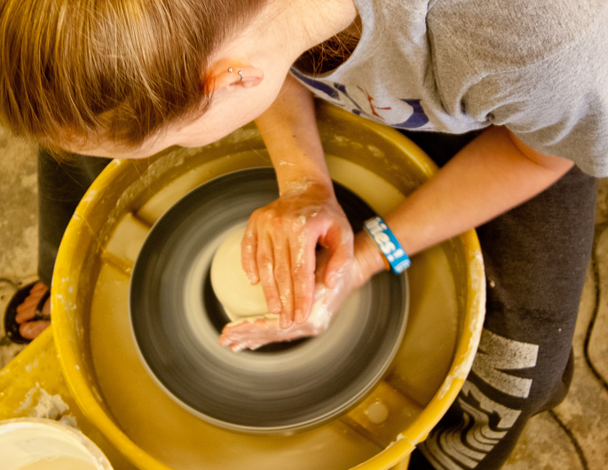 Newman ceramics student