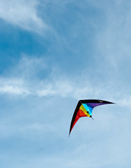 wing(0.0), extreme sport(0.0), toy(0.0), individual sports(1.0), sports(1.0), windsports(1.0), wind(1.0), kite(1.0), blue(1.0), sky(1.0), sport kite(1.0),