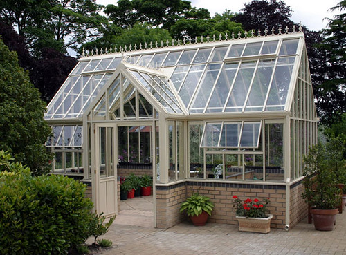 A Victorian Lodge Glasshouse with a double door entrance
