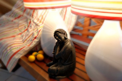 The Good Year: light of a black Buddha, reflecting on the past year, Indonesian teak bench, lemons, two lamps, bedspread, San Mateo, California, USA by Wonderlane