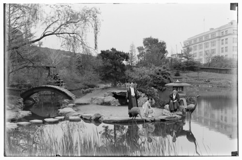 Japanese garden. View from W. shore. Three natives in costume posing on island-1925. 1925 Louis Buhle. All rights reserved.