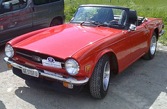 automobile, vehicle, performance car, classic car, land vehicle, luxury vehicle, triumph tr6, convertible, sports car,