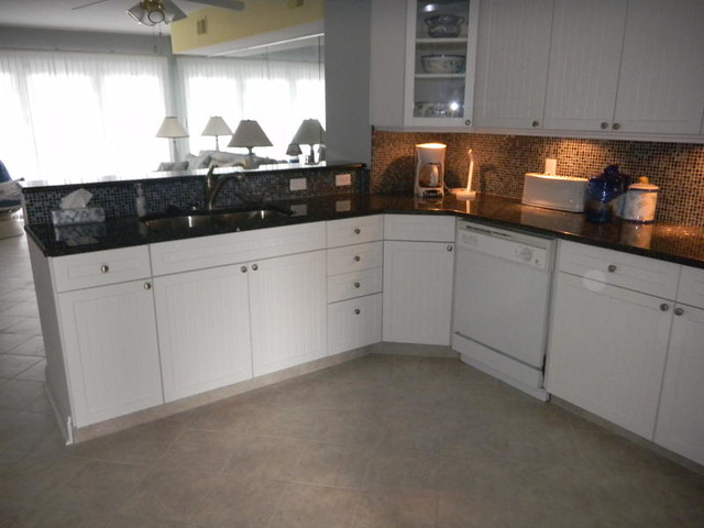 Kitchen ceramic tile floor beadboard cabinets under for Ceramic tile under kitchen cabinets