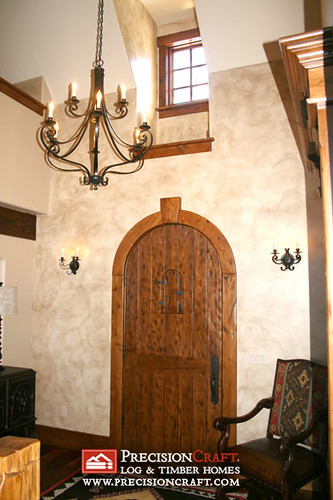 Handcrafted Wood Door Adds Character to Custom Timber Frame Home
