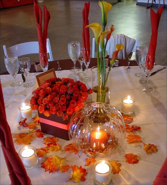 Orange roses and pumpkin lantern wedding reception