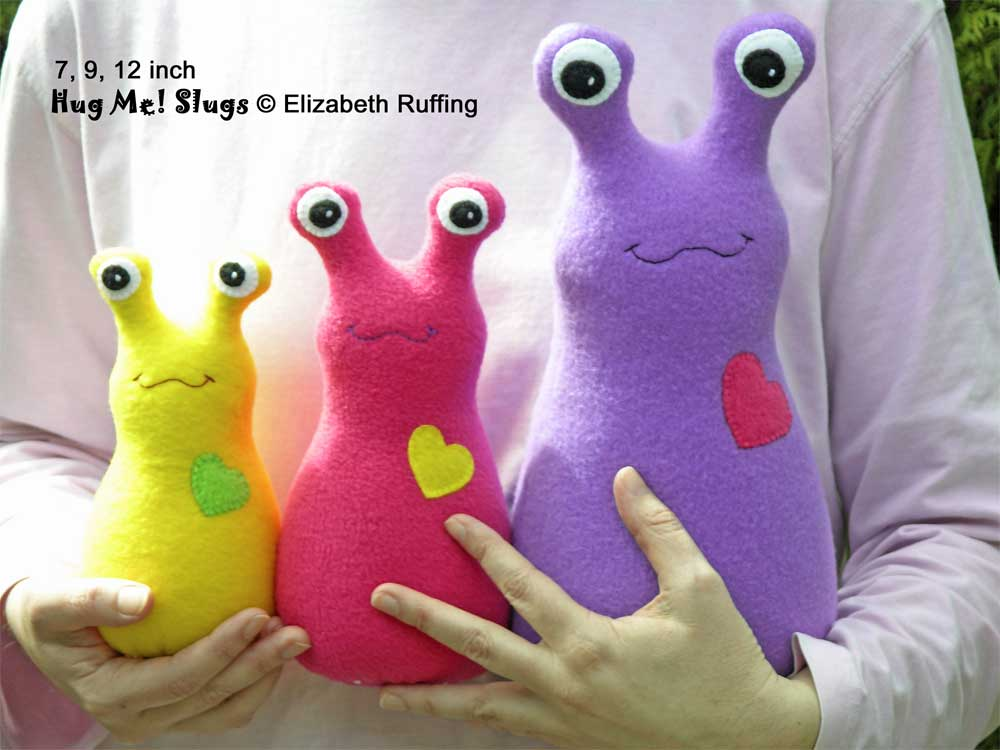 Slugterra and assorted fleece Hug Me Slugs, original stuffed animal art toy by Elizabeth Ruffing