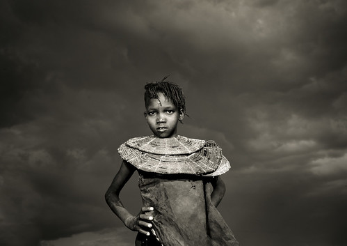 Pokot girl with necklace under a cloudy sky - Kenya