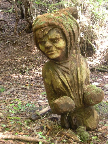Creepy chainsaw sculpture imp/toddler/leprechaun thing.
