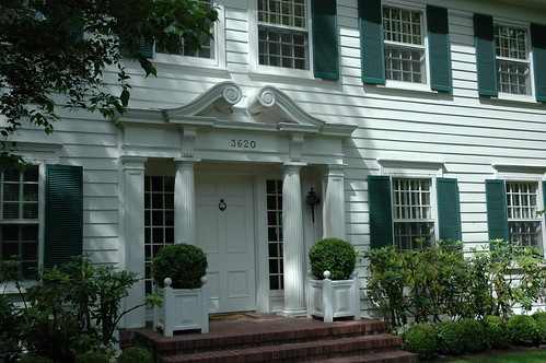Fancy front doorway, columns, green shutters, formal design, Washington Park neighborhood, Seattle, Washington, USA by Wonderlane
