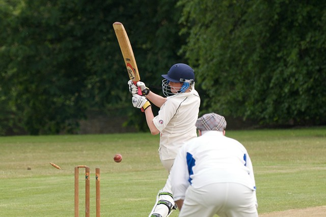 Cricker batsman hitting a ball