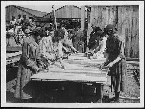 Crowd of women carpenters who work for Government contractors in France