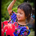 Young girl and her inflatable teletubbie, Guatemala