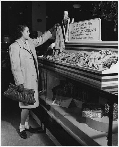Silk Stockings Which Can No Longer Be Worn Are Being Collected in Stores Throughout the Country for Conversion into Powder Bags Which Propel the Projectile in Big Naval and Coast Defense Guns. ca. 12/1942