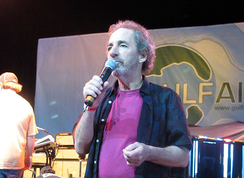 Harry Shearer addresses the crowd between sets at Gulf Aid