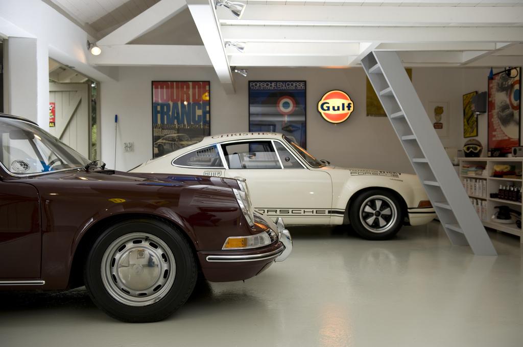 World 39 s most beautiful garages exotics insane garage for Garage renault rots