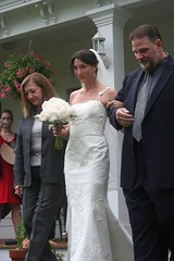groom(0.0), groom(0.0), bride(1.0), bridal clothing(1.0), gown(1.0), wedding reception(1.0), event(1.0), wedding(1.0), marriage(1.0), man(1.0), woman(1.0), wedding dress(1.0), dress(1.0), ceremony(1.0),