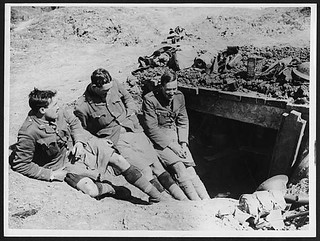 Three officers of the Gordons chatting at entrance of a dug-out