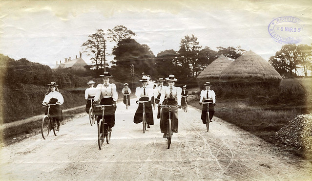 Lady cyclists riding down hill
