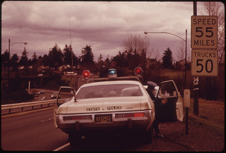 Motorists Were Stopped by the State Police When They Exceeded the 55 Mile an Hour Limit on Highways Which Had a Previous Limit of 70. The Action Was Done to Conserve Fuel During the Crisis in the Pacific Northeast. This Is on 80 N East of Portland 12/1973