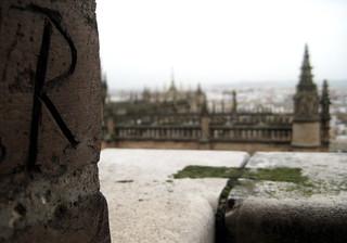 Image of La Giralda near Triana. sevilla andalucía spain carving names giraldatower lagiralda