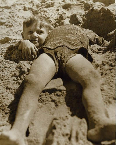 Billy and Graham Green from the Salvation Army Camp practise a little deceit, Collaroy Beach, ca. 1940 / photographer unknown by State Library of New South Wales collection