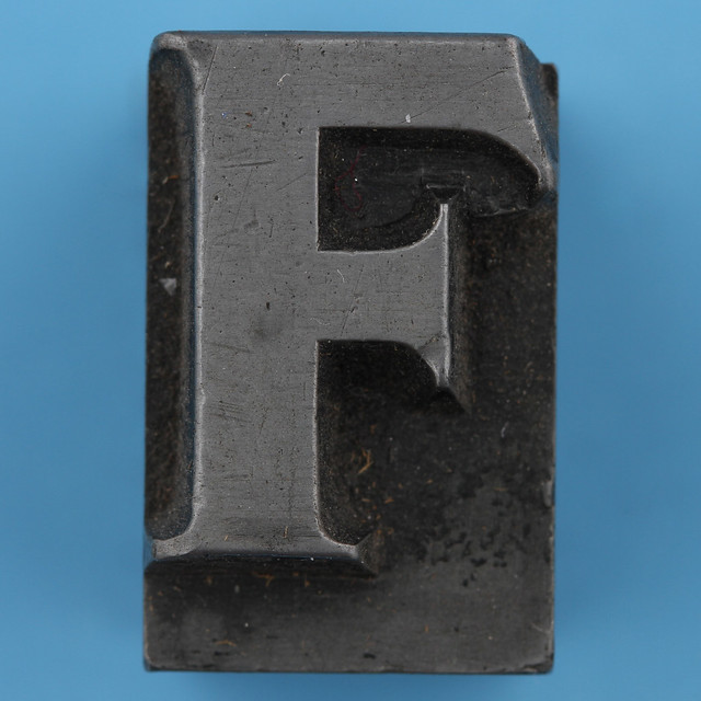 metal type letter F