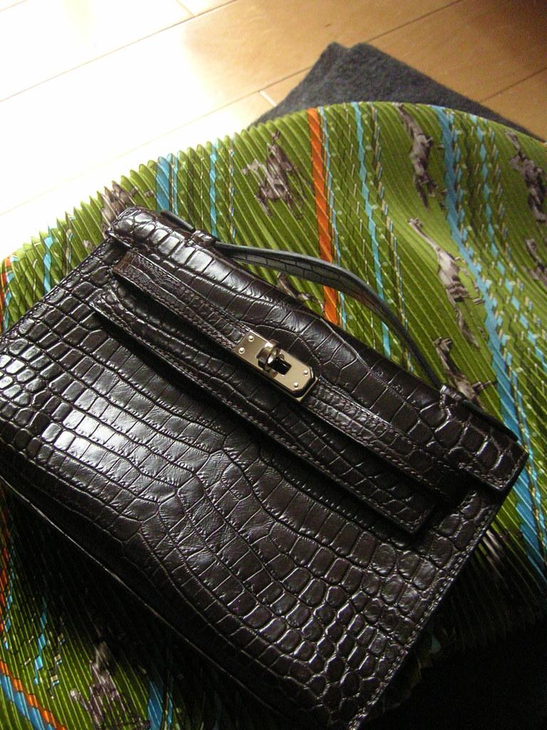 ... Hermès Kelly Pochette Matte Havane Niloticus Crocodile with palladium  hardware  fdcd2ea771c29