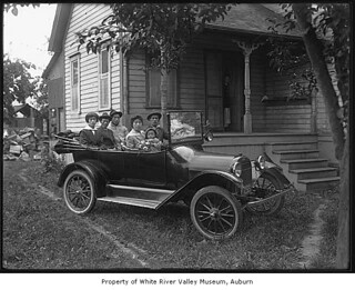 Japanese Families in a car outside a house in Kent, 1917