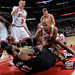 Taj Gibson fights for the ball with LaMarcus Aldridge