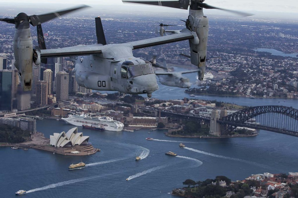 Three MV-22B Osprey tiltrotor aircrafts fly in formation above Sydney, Australia.