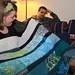 Tasha admiring the quilt Jeremy got her. by the boastful baker