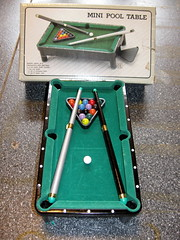 lawn game(0.0), recreation(0.0), carom billiards(0.0), indoor games and sports(1.0), individual sports(1.0), play(1.0), snooker(1.0), sports(1.0), cue stick(1.0), pool(1.0), billiard table(1.0), table(1.0), games(1.0), green(1.0), english billiards(1.0), cue sports(1.0),
