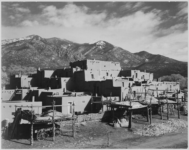 """Full view of city, mountains in background, """"Taos Pueblo National Historic Landmark, New Mexico, 1941."""""""