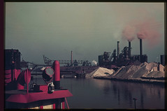 P-17= Steel Mills at mouth of Calumet river Chicago. Fire and boat at left. C.W. Cushman Nedill