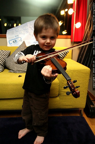 playing his baby violin