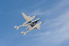 Mothership VMS Eve carries spaceship VSS Enterprise over Spaceport America. Photo by Jeffrey Vock