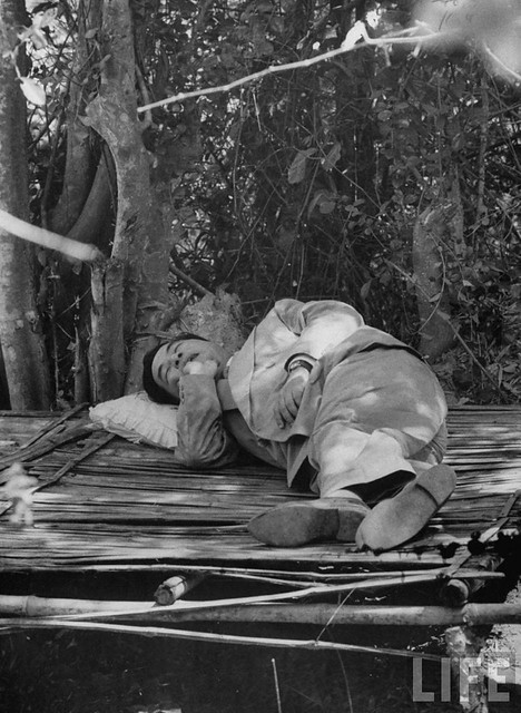 5-1956 South Vietnam's President Ngo Dinh Diem sleeping under the trees during his trip to refugee settlements