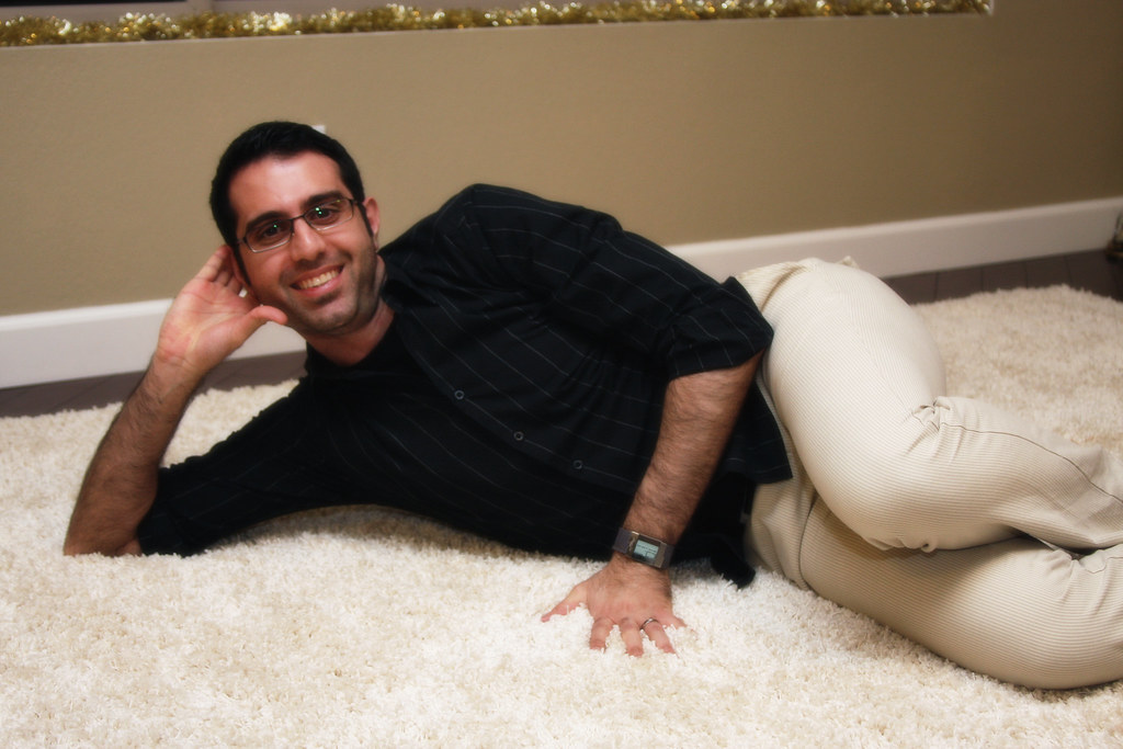 Houtan contemplates a career in adult film while running his hands through the shag carpeting.