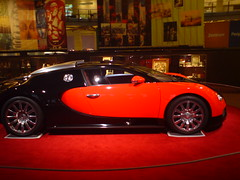 automobile(1.0), bugatti(1.0), automotive exterior(1.0), wheel(1.0), vehicle(1.0), automotive design(1.0), auto show(1.0), bugatti veyron(1.0), city car(1.0), land vehicle(1.0), supercar(1.0), sports car(1.0),