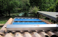 Putting up the new vacuum tube solar water heater
