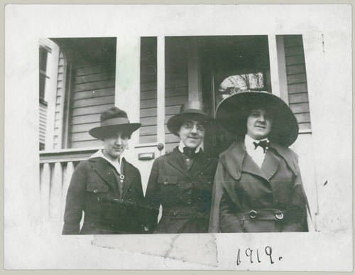 Three women and hats