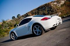 nissan 370z(0.0), automobile(1.0), automotive exterior(1.0), wheel(1.0), vehicle(1.0), automotive design(1.0), porsche(1.0), porsche cayman(1.0), land vehicle(1.0), luxury vehicle(1.0), supercar(1.0), sports car(1.0),