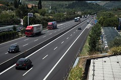 traffic congestion(0.0), driving(1.0), asphalt(1.0), highway(1.0), traffic(1.0), vehicle(1.0), transport(1.0), road(1.0), lane(1.0), controlled-access highway(1.0), shoulder(1.0), road surface(1.0), infrastructure(1.0),