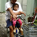 Ibu dan anak bersepeda. : A mother and child cycling. Photo by Aditya